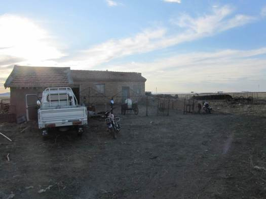 Damrin's brick house, with a small truck and motorbike outside. Mongolian yurts, oxcarts and horses have quietly disappeared from the herders lives.